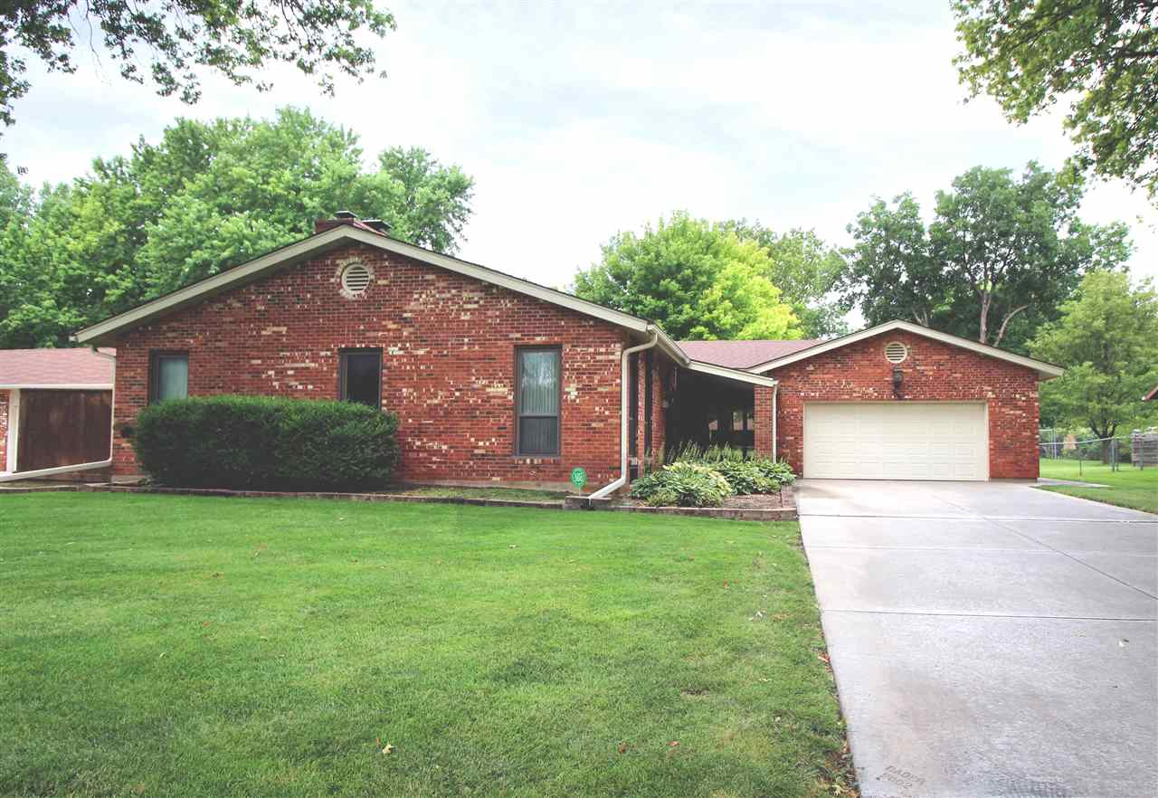 Full brick immaculately kept one owner home in the desirable area of Westlink.  3 Bedroom  2 bath .  There is a Walk in closet in master bath and large closets throughout .Newer windows and appliances. 2 brick Fireplaces . Large open rooms. The counter tops are all Korean including shower in Master bath. The wood work is beautiful throughout the home.  Downstairs you will find a 12x8 cedar closet also. There is a large wine cellar, screened in porch and a composite deck. The garage is an Over sized 2 car (24x24) with lots of extra parking in the driveway. Enjoy your beautiful well maintained large fenced yard with mature trees. Home is checked yearly and has a bait system for termites and the 1 year warranty is transferable. Washer and dryer stay and so does the freezer and all are newer. No showings till Sunday as home is being Prepared for its debut. Open house Sunday August 16  from 2 to 4.