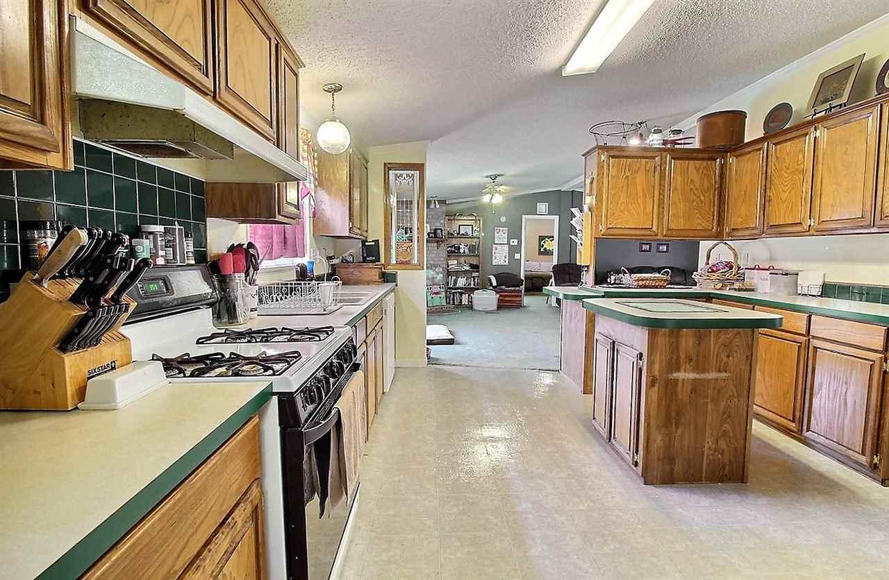 For Sale: 1120 E 10TH ST, Wellington KS