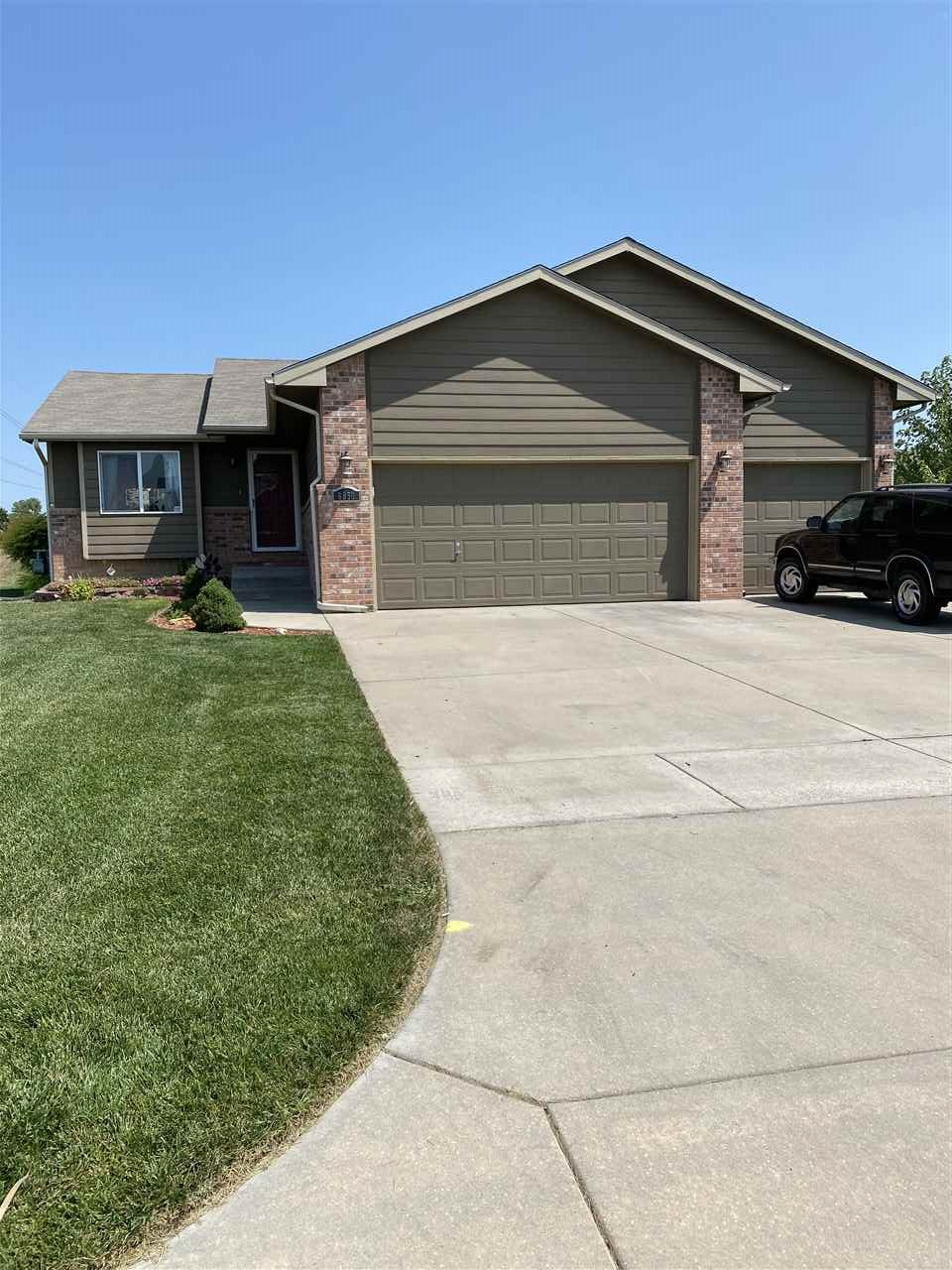 SELLER IS OFFERING $1,500 CREDIT AT CLOSING FOR CARPET/FLOORING UPDATE.  Desirable home located in the High Ridge subdivision, Park City.  VALLEY CENTER SCHOOLS!  House sits on private lot next to a common area.  Very livable 3 bedroom, 2 bath home with open concept kitchen/dining room.  Private master bath adjacent to the master bedroom with his & hers closets.  View of the lake from the living room.  Main floor laundry room.  Unfinished basement ready for buyer's completion of their own design.  Landscaped and sprinkler system.  Seller is offering $1,500 credit at closing for flooring/remodel.  WEEK DAY SHOWINGS ONLY AFTER 5PM.  WEEKEND SHOWINGS WITH 1 HOUR NOTICE.