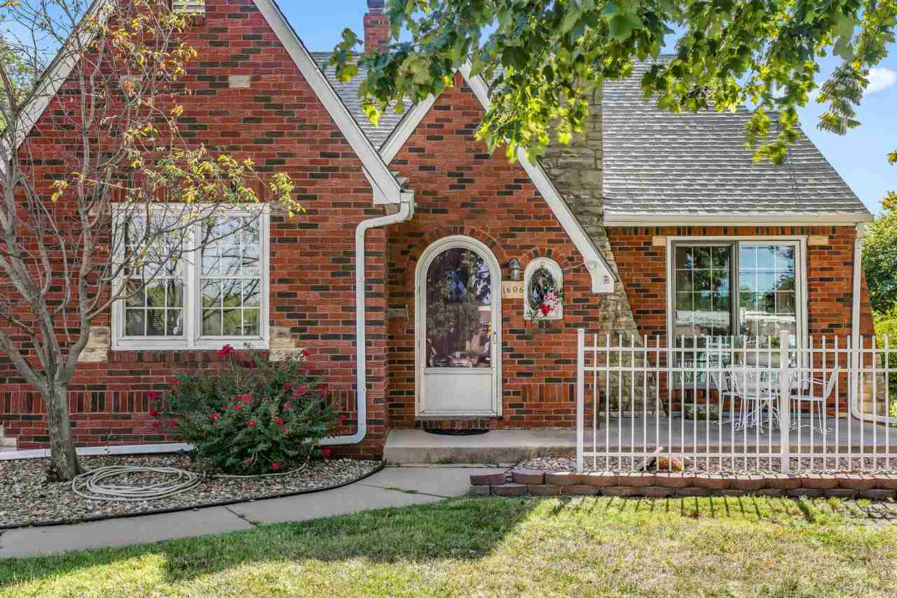 Back on the market! Charming full brick Tudor style home on a large corner lot with mature trees has
