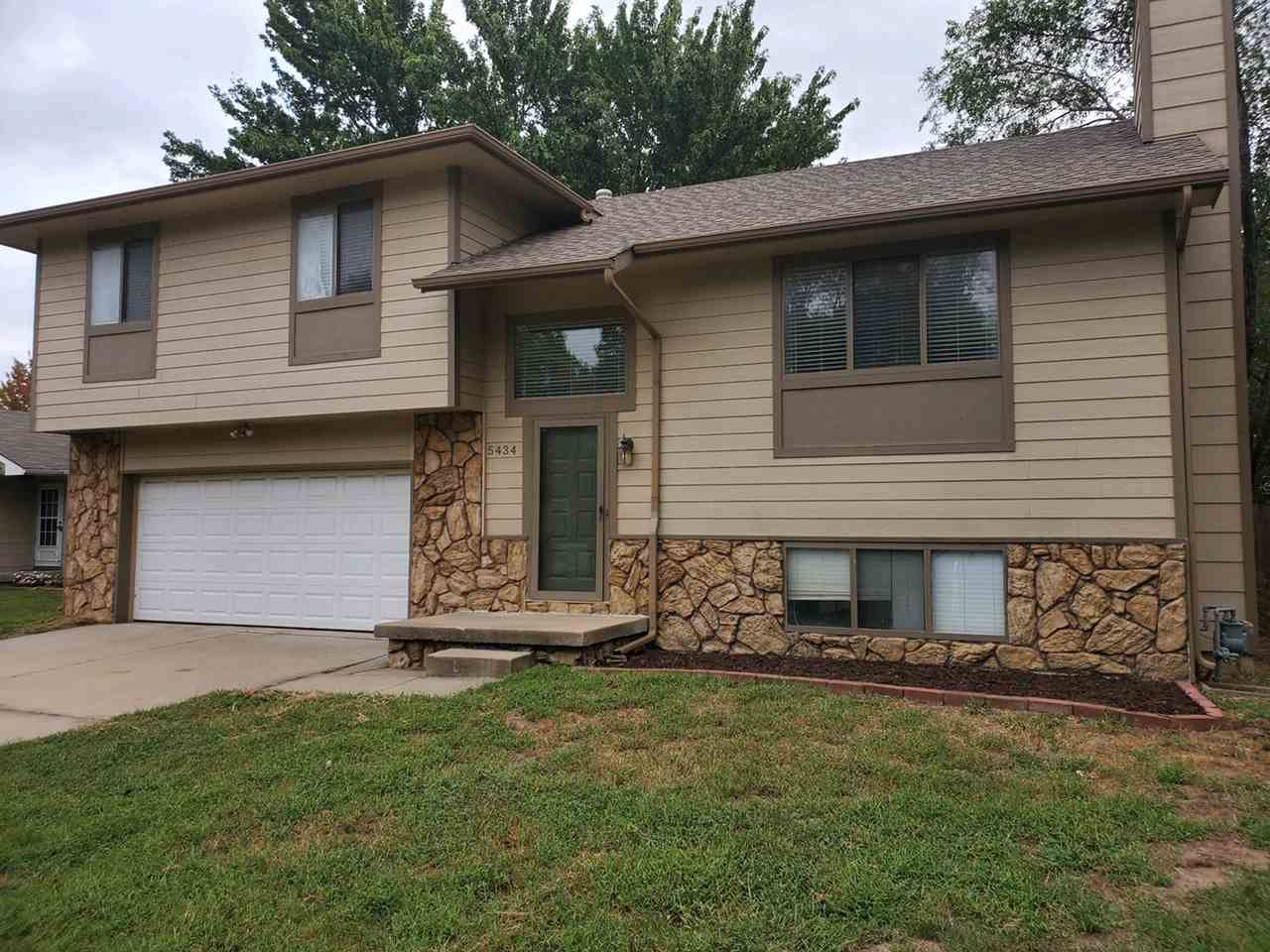 This charming home is in a much desired area and won't last long! This home is move in ready. New carpet throughout most of the home, nice tile floor in the kitchen and bathrooms. The kitchen has much desired white cabinets, and a large separate dining area for eating. The huge deck in the back will be great for entertaining. The view out basement has a fireplace in a second family room, for extra space. The laundry room, has extra storage and a 3/4 bath in the basement. Schedule your showing today!