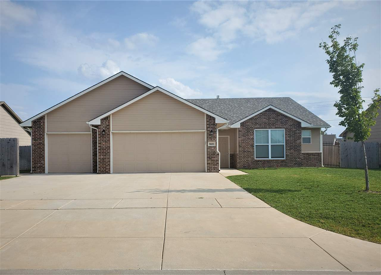 Beautiful 0 entry ranch home with over 2,000 sq ft on ground level. It boasts a large open living ar