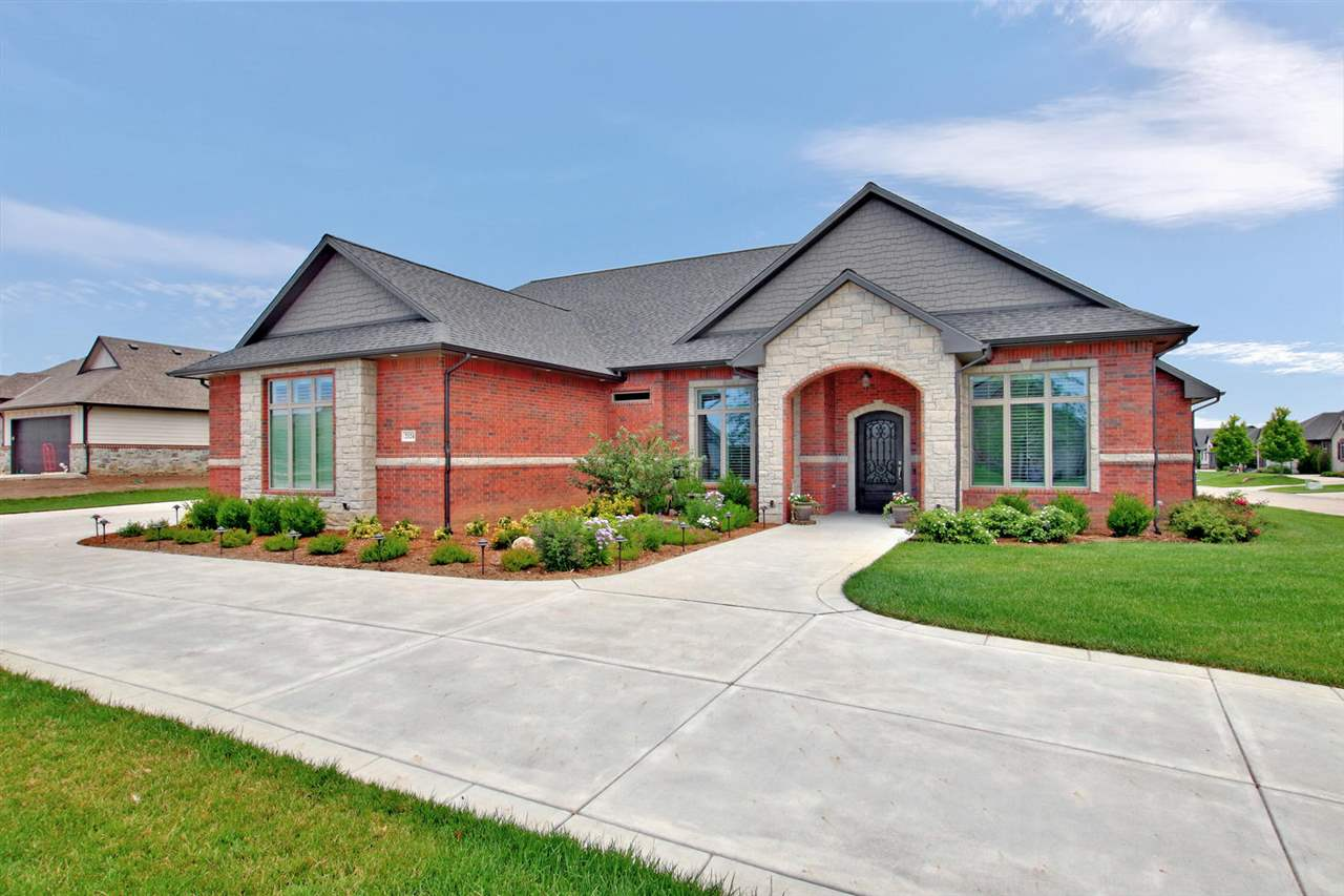 Looking for a spacious one level zero entry full brick and stone home. This custom built award winni