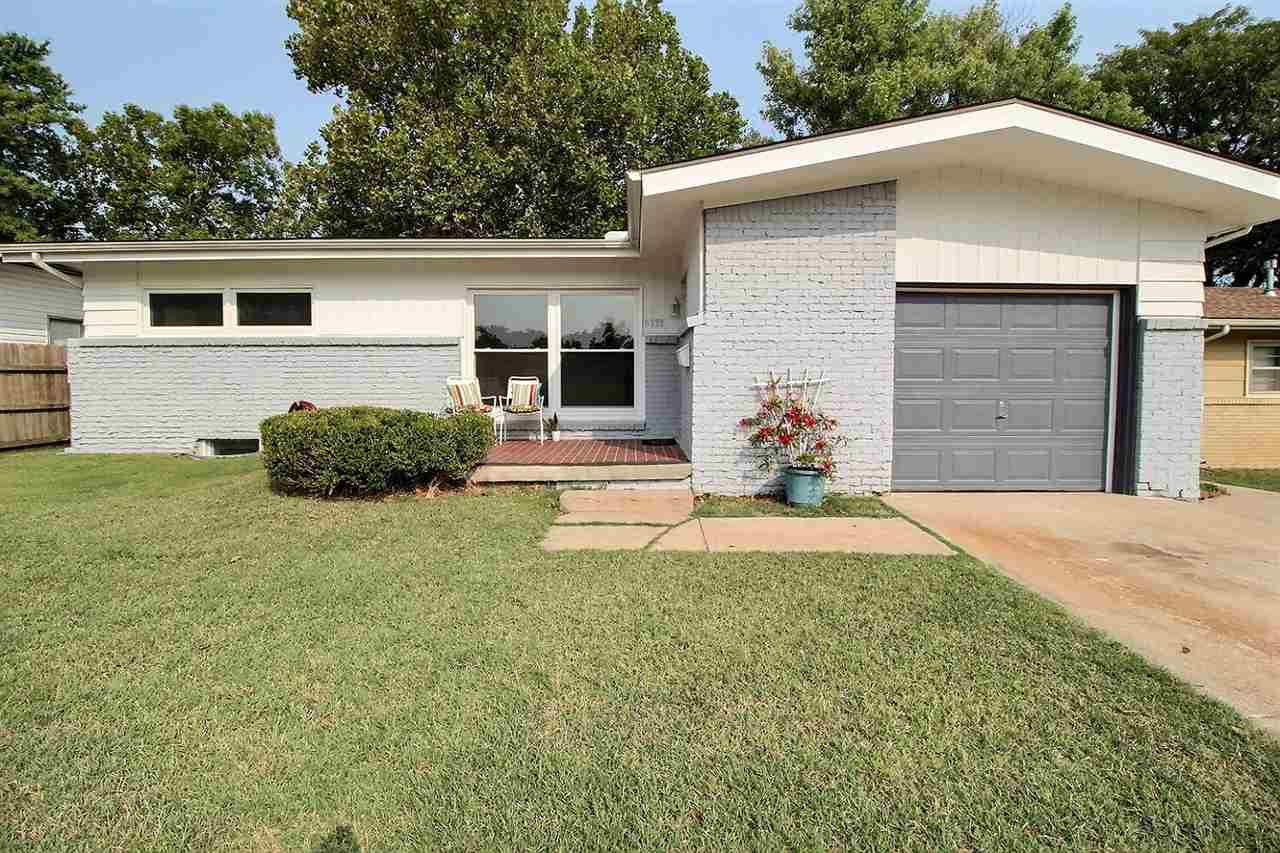 Darling updated ranch home with genuine wood floors and low maintenance aluminim siding for sale! If