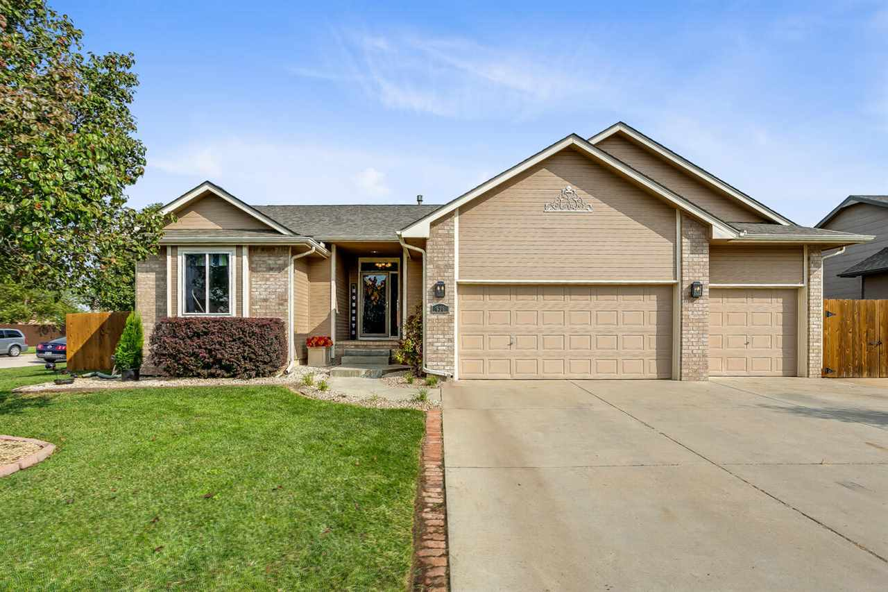 This lovely home is tucked away in the quiet Saddlebrook community that feels much like country livi