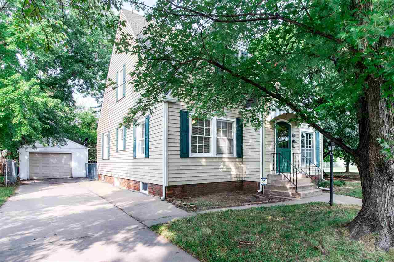 Cute as a button and move in ready - this home has been updated with refinished wood floors, new car