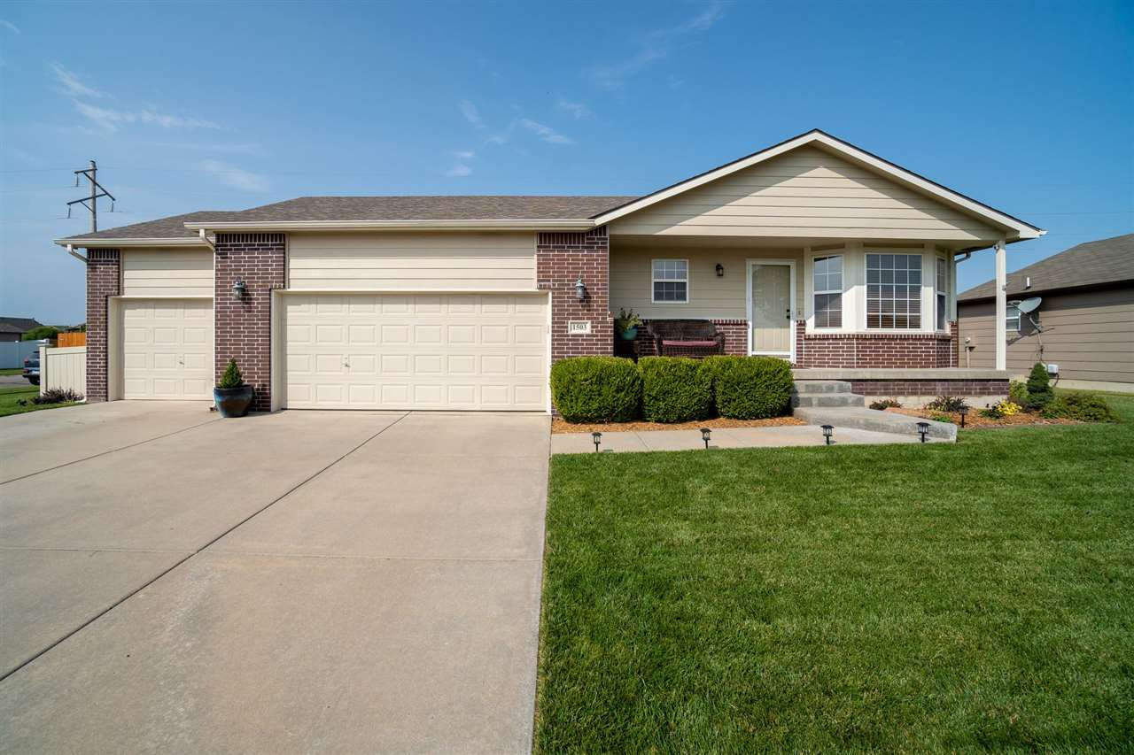Meticulously well-maintained home in West Wichita (135th & 13th)!   The pride of ownership is withou
