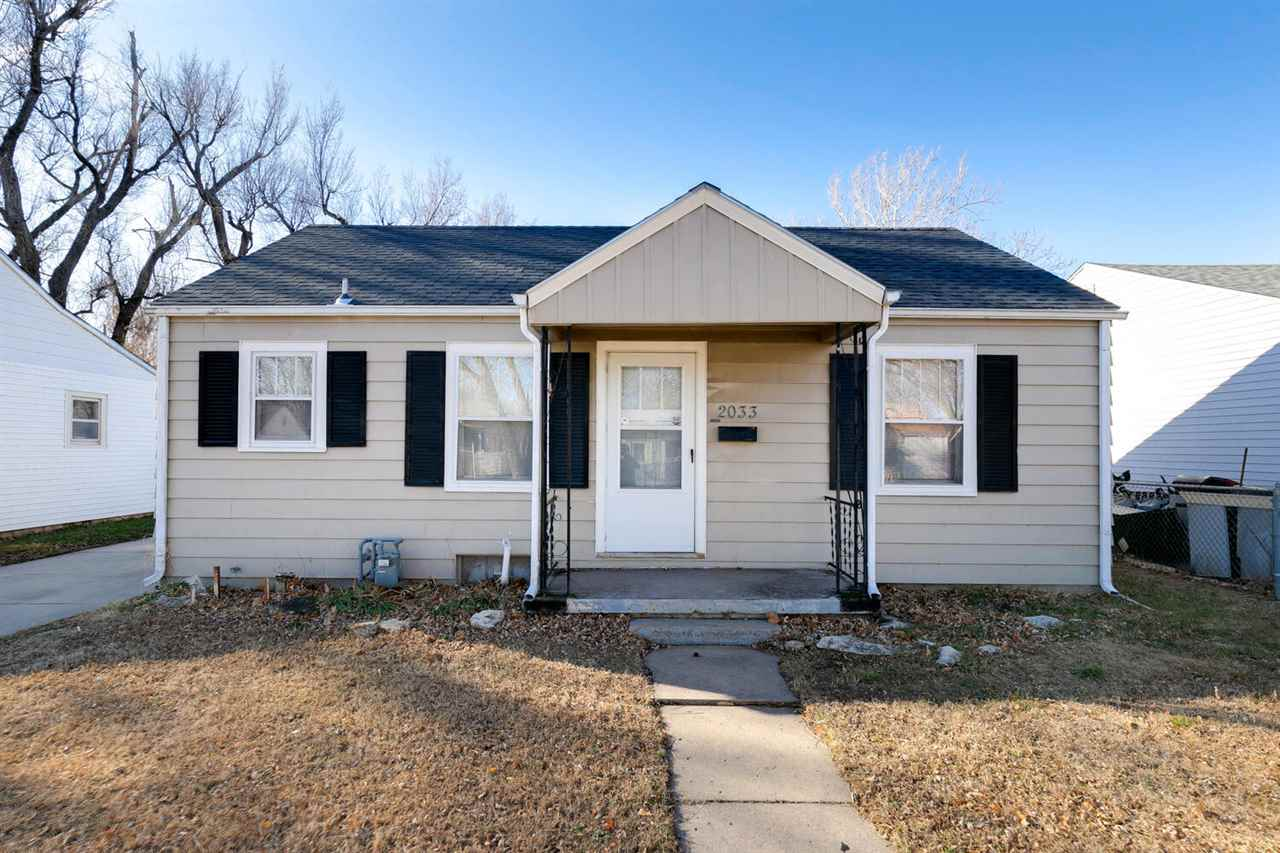 ADORABLE 2 BEDROOM 1 BATH RANCH THAT'S MOVE IN READY! WELCOMING INTERIOR WITH WOOD FLOORS, WHITE TRI