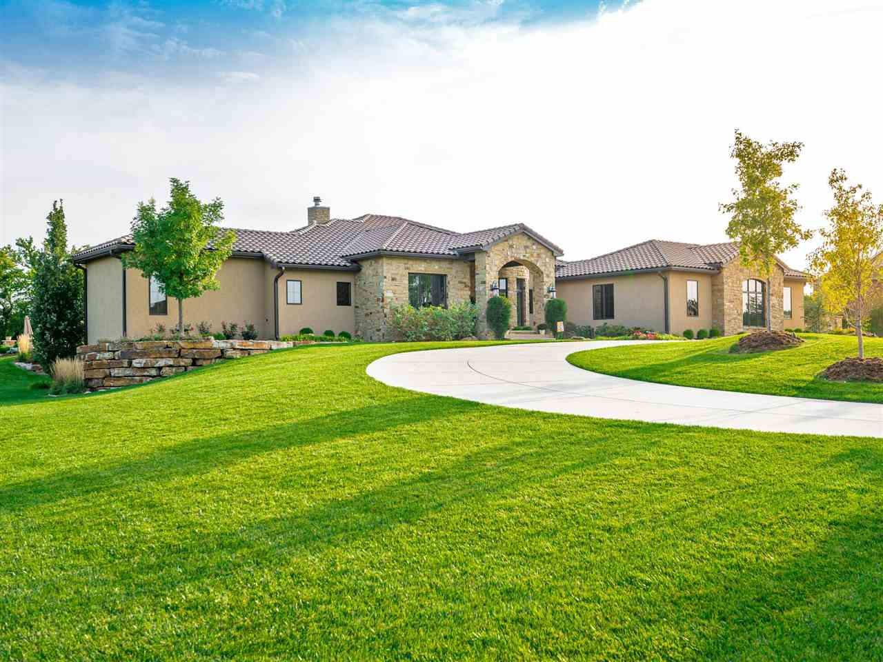 IMMACULATE PROPERTY WITH JUST OVER 2 ACRES OF MANICURED LANDSCAPING AND A BREATHTAKING COVERED ENTRA