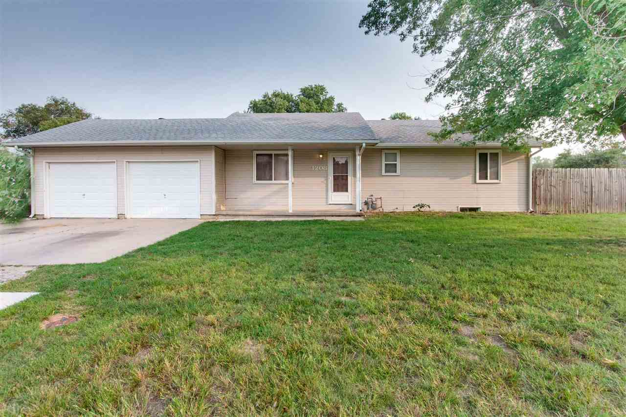 This 3 bedroom 2.5 bath home is located on a corner lot in the desirable Haysville School District.