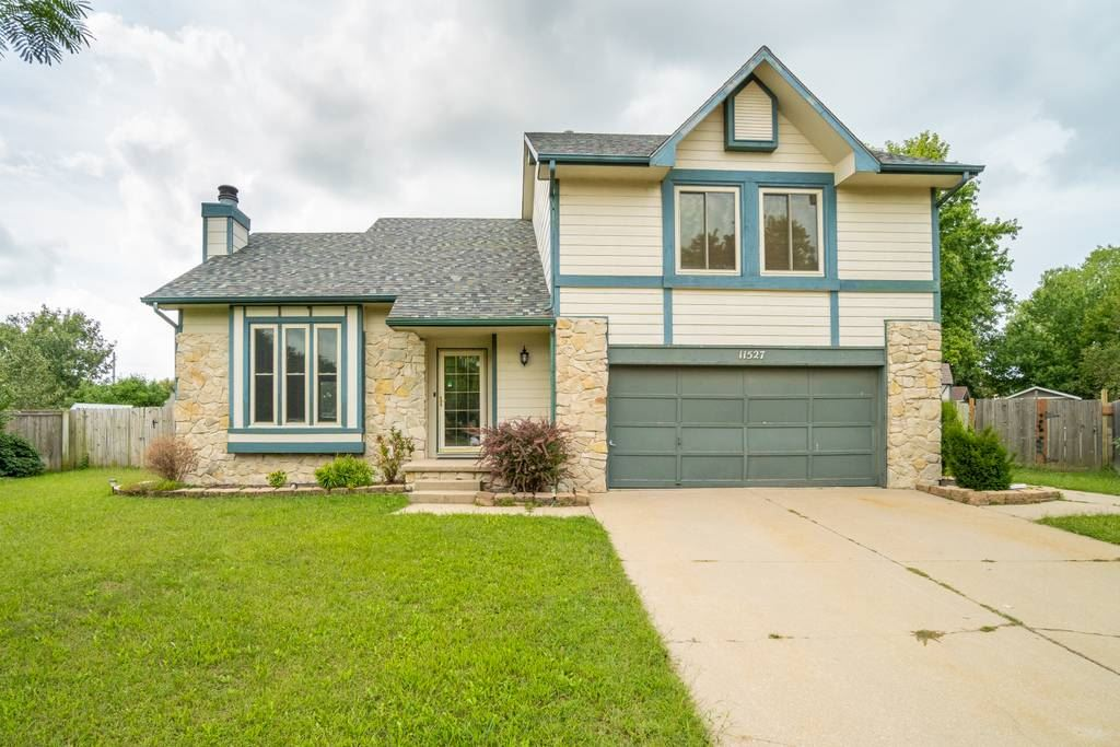 Great home for entertaining, inside and out! This 1.5 story home greets you with a spacious living r