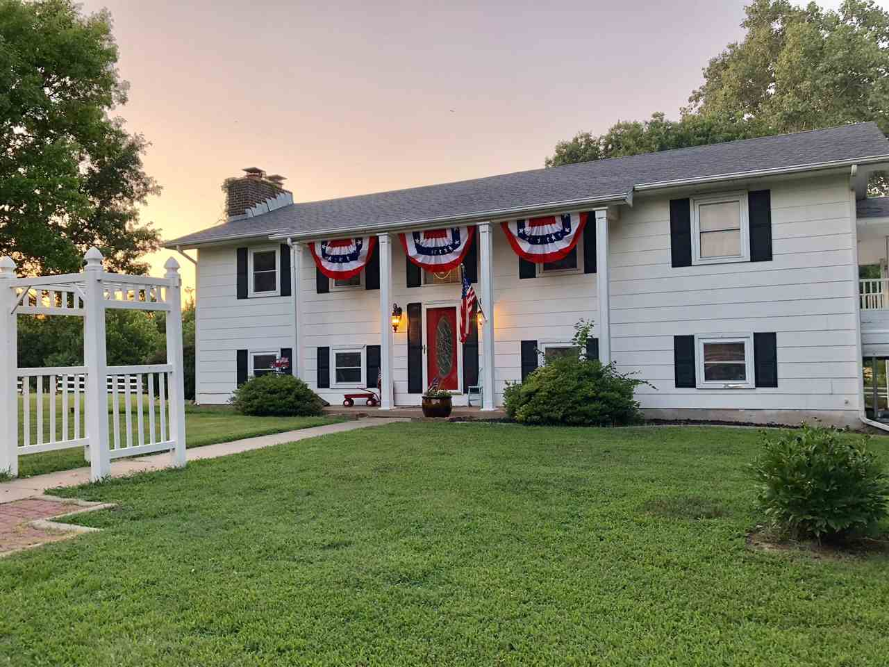 The quiet, country life close to town! Charming updated home on 3.02 acres just minutes from Wichita
