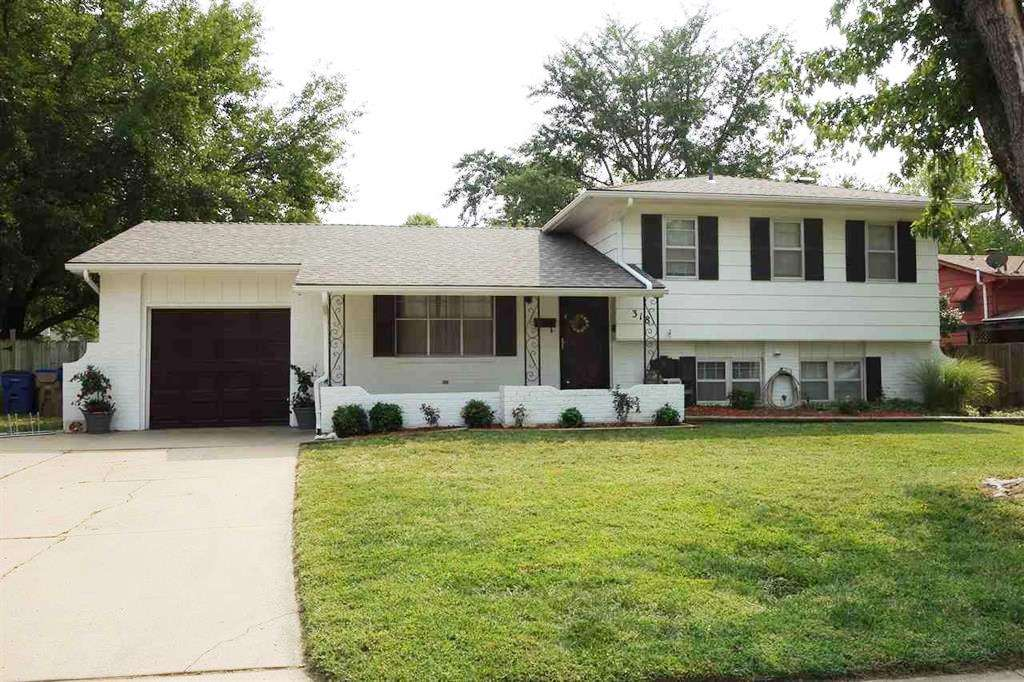 Do not miss this beautiful 4 bedroom, 2 bathroom home located on a quiet street with mature trees.