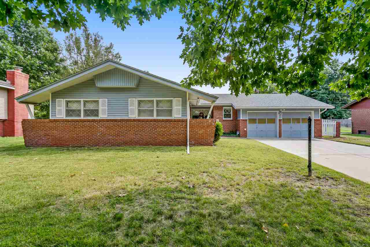 This IMMACULATE mid century modern is located in highly desirable Westlink Village in West Wichita.