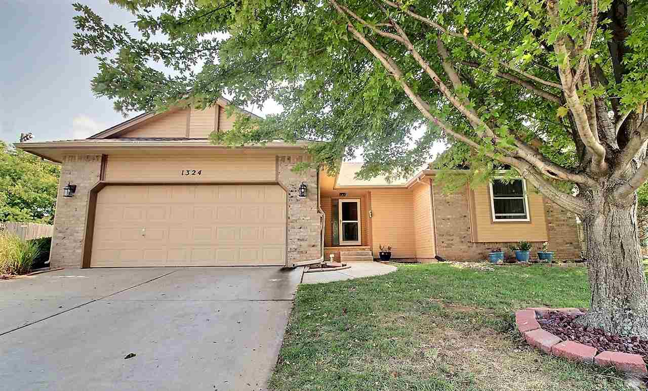 Beautifully updated 4 bedroom, 3 bath home with a huge bonus room in the desirable Derby school dist