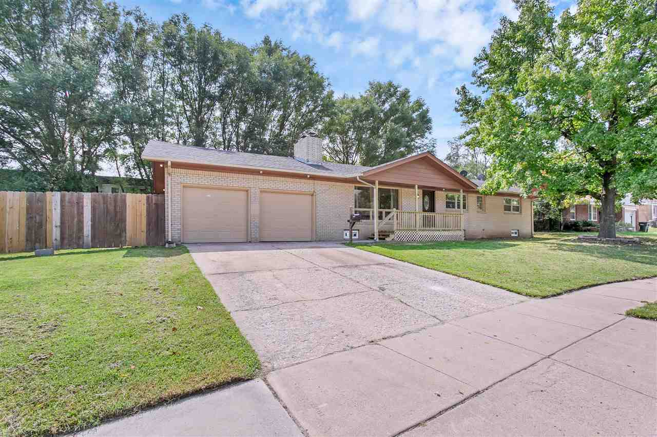 Well maintained brick ranch with fenced yard, on an oversized lot with a new front porch and a nice