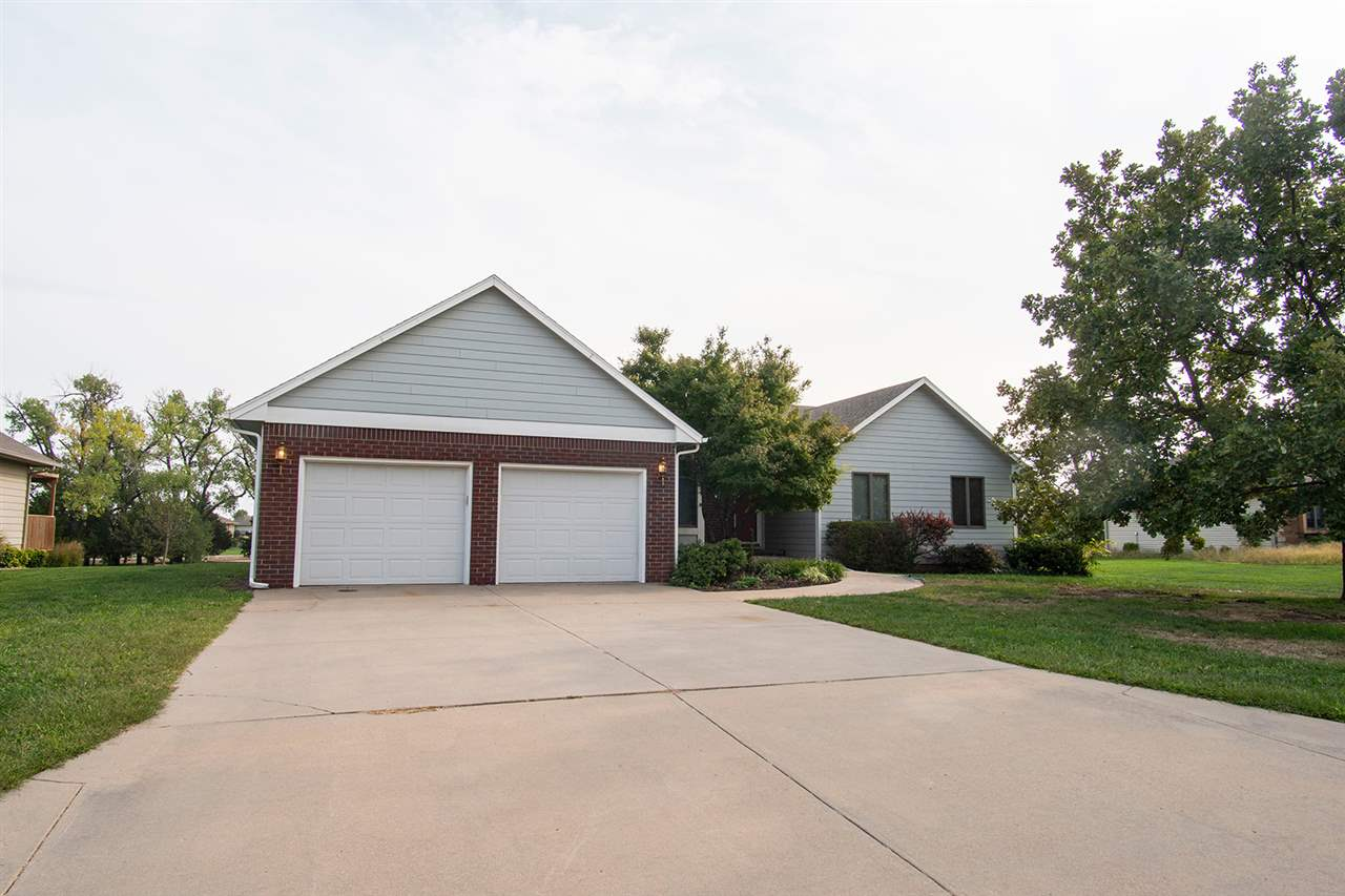 4 bedroom, 3.5 bathroom ranch home in the Quail Creek subdivision in Newton, Kansas!!! This home bac