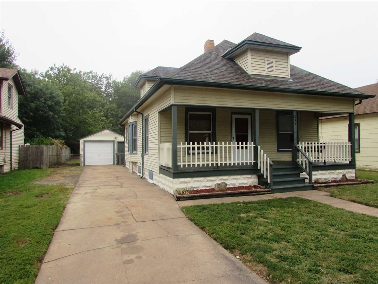 Perfect Starter Home in Move-In-Condition! This Very Nice Updated Bungalow features New Carpet and F