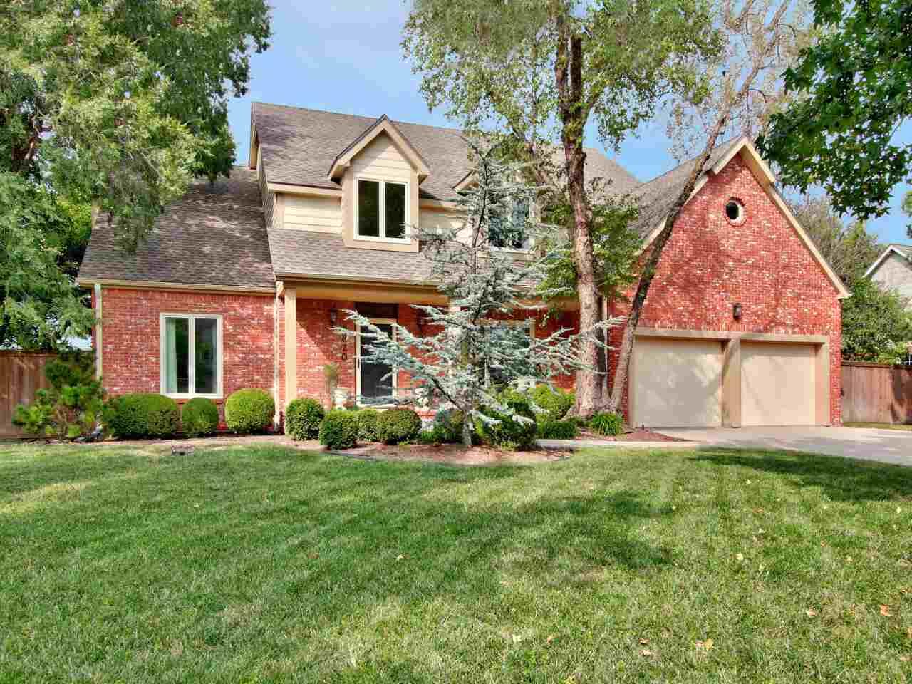 This exquisite brick home is nestled in one of Wichita's most prestigious neighborhoods, Wilderness