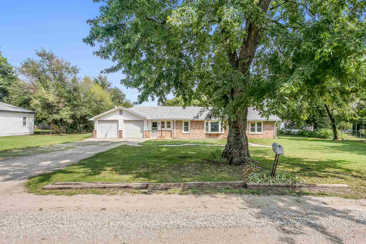 Stretch out and breathe in this home situated on a half acre, and close to the anywhere in town!  Th