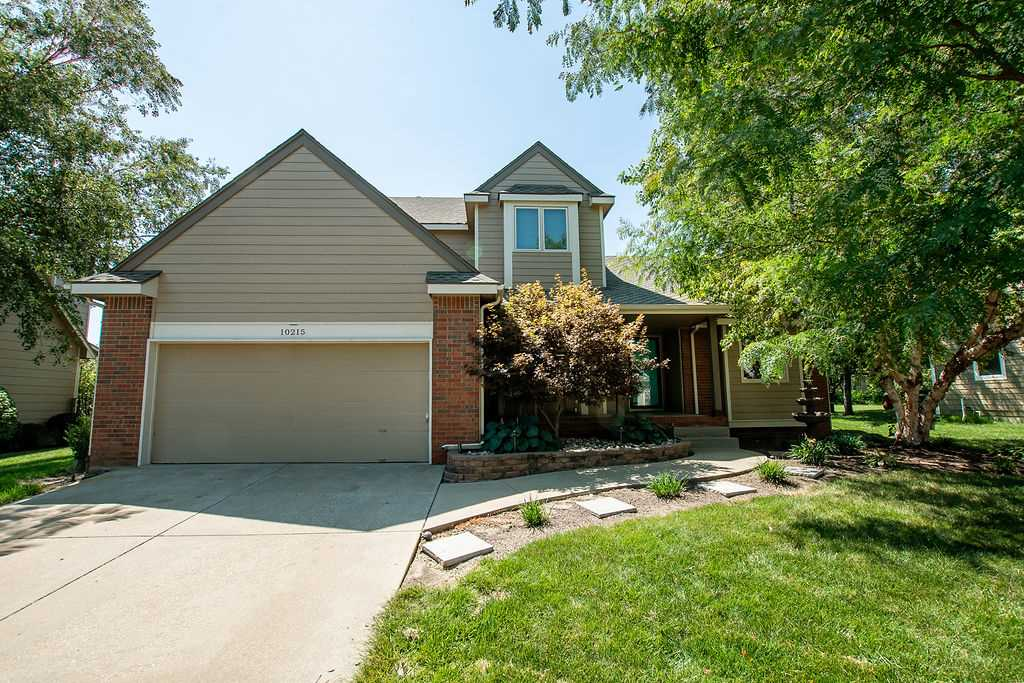 On a spacious landscaped lot, this awesome home features a living room with built in entertainment c