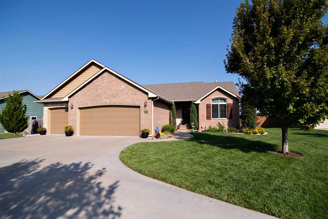 Are you searching for a custom-built home in a smaller town but still want to be close to all Wichita has to offer?  This impeccable  6 BR 3 BA 3 Car Garage Ranch in Clearwater won't disappoint with no neighbors behind you, just country views. The attention to detail is evident from the curb with lovely landscaping and an impressive circle drive. Great Room, Dining and Kitchen are open concept with many upgrades including hardwood floors, vaulted ceilings, gas fireplace surrounded by beautiful woodwork & built-ins and a drop zone in the foyer. A wall of windows allows for an abundance of natural light. The chef's kitchen features beautiful knotty alder cabinetry, granite countertops, tile backsplash, large eating bar, 2 pantries + all stainless appliances stay. Because of the split Bedroom plan, the Master Suite is truly private boasting coffered ceilings & walk-in closet. Double sinks, over-sized stand-alone shower, jetted tub are found in the spa-like Master Bath. Rounding out the main level are 2 additional BRs, nice Hall Bath and convenient laundry. The finished basement is the perfect space for entertaining or for your teenage kids. Big Family Room, plenty of space for game tables with hardwood floors, Dry Bar with Wine fridge + a fun play area under the stairs, perfect for young kids & grandkids. Three more nice BRs, 3rd full Bath and 2 storage areas complete the lower level. With no neighbors behind you, it will be fun for family & friends to gather on the covered deck & open patio with wood privacy fence, dog run, storage shed, irrigation well, sprinkler system, lovely landscaping. New sidewalks from garage to patio. Insulated & heated garage sporting a handy sink, built-in shelving, painted floor. Radon mitigation in place, new water softener, custom blinds throughout. Close to schools, park, swimming pool, churches plus a short drive to Wichita. Don't miss out on this beautiful well-cared for home with all the extras!! Nothing to do but move in!! - Call to