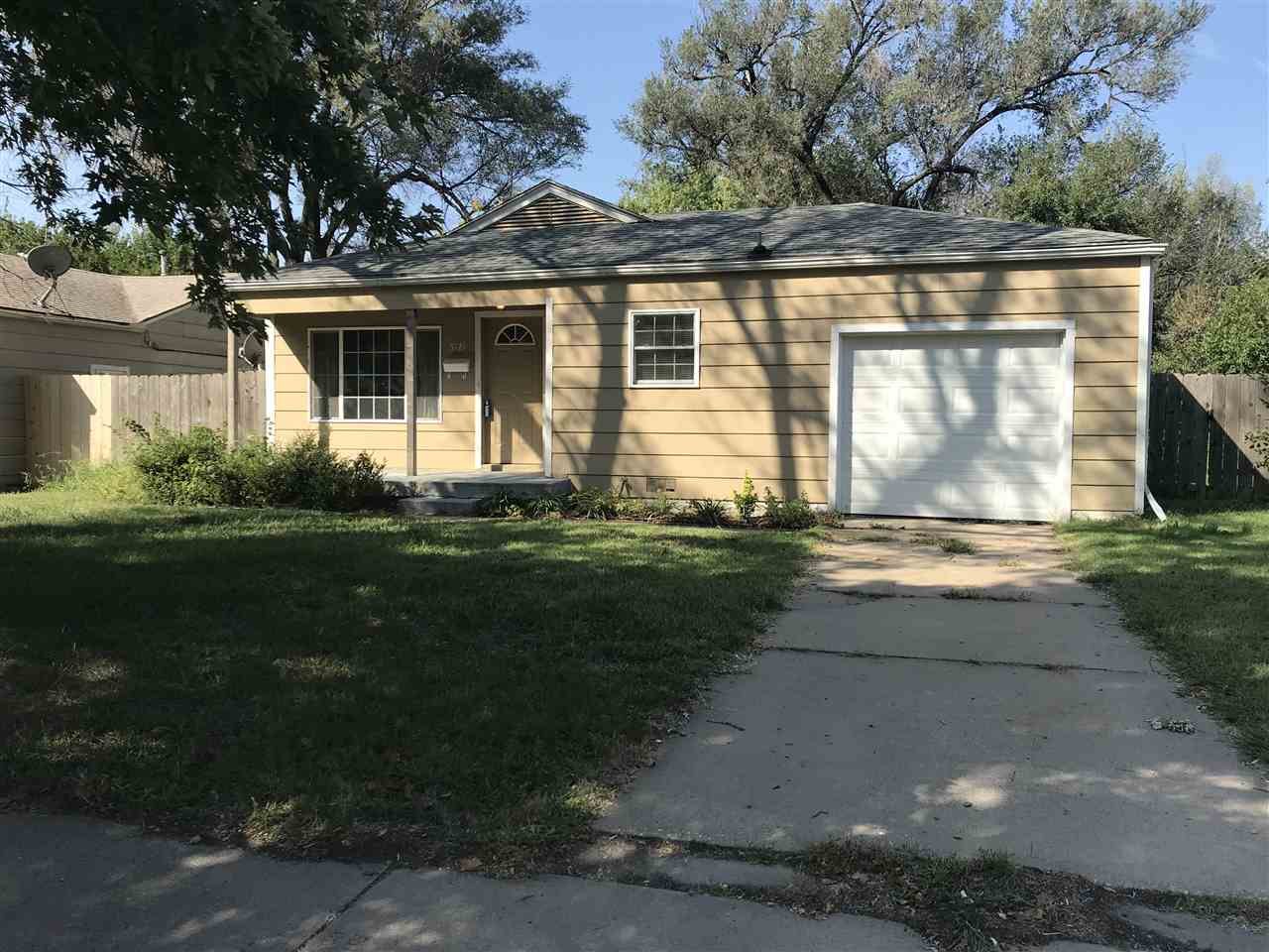 Nice 3 bedroom 1 bathroom with 1 car attached garage, hardwood floors through out, vinyl windows, ne