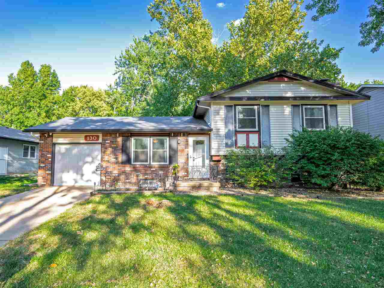 This home is priced to sell! Gas brick fireplace. Large treed lot. Great location, within walking di