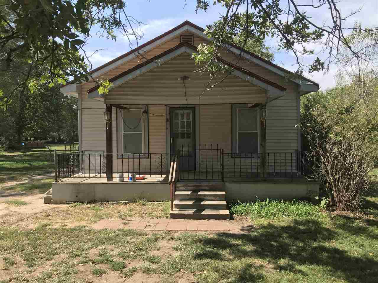 One Bedroom home could possibly be 2 bedroom.  Nice Big Lot almost one half acre.  3 storage type bu