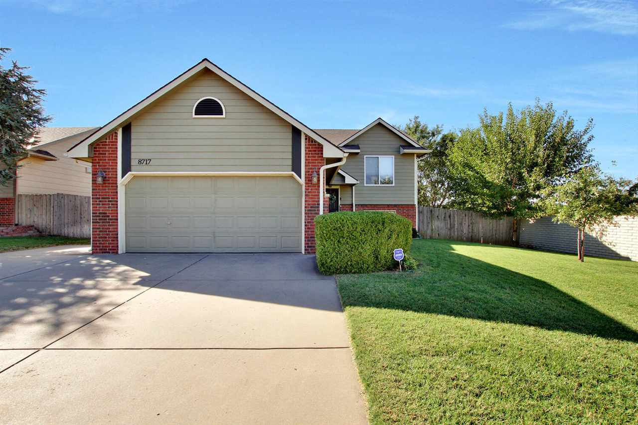 Great west side home in Maize School District with 3 bedrooms, 2 full bathrooms and a large fenced y