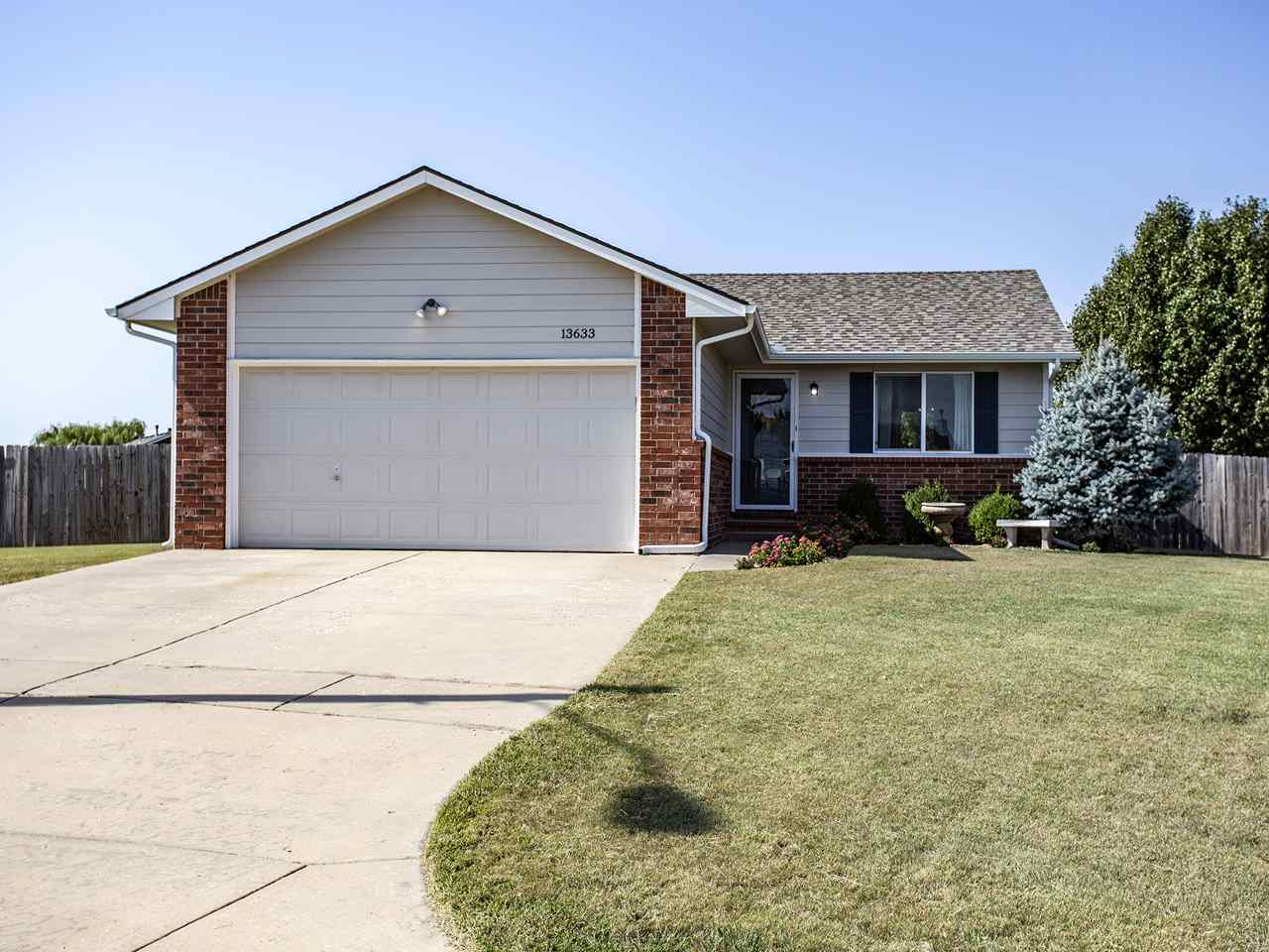 Darling 3 bedroom home with new wood laminate flooring and Paint. Yard has Low maintenance Buffalo g