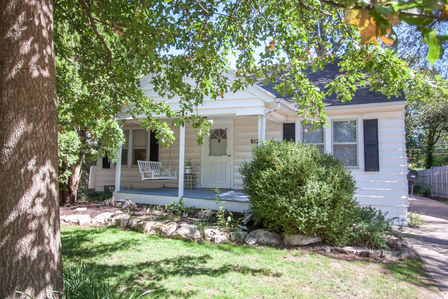 This one is an oldie, but a goody!  A charming front porch and vintage screen door welcome you into
