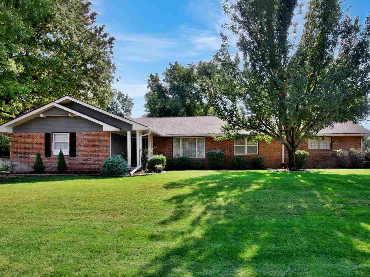 Gorgeous home with a large shop on a 1/2 acre lot in the Goddard School District! This 3 bedroom, 3