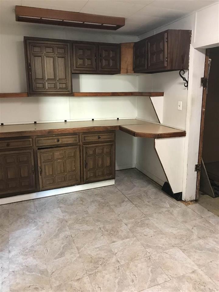 For Sale: 702 W 11th St, Newton KS