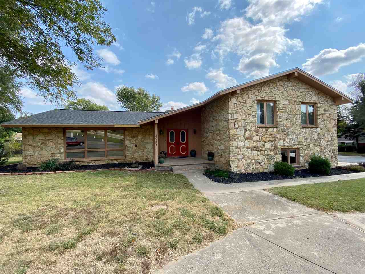 Wow! This home will check all of your checkboxes and more! Located in an excellent neighborhood on a large corner lot with plenty of parking this gorgeous stone home is sure to impress! With over 2700 sqft, 4 bedrooms, 2 full baths and 2 half baths, and partial  basement it plenty big for a large family with space left over!  You will not have to worry about how to entertain the kids next summer because they will be thrilled to find an inground gunite pool with automatic pool cover to keep them busy! Additionally, the home has had a brand new roof and seller will offer flooring allowance at closing with acceptable offer! Hurry and call listing agent today before this home is gone!
