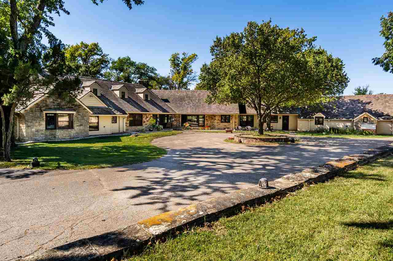 Rare Opportunity!  Serene and peaceful 80 rolling acres with a William Caton designed sprawling ranc