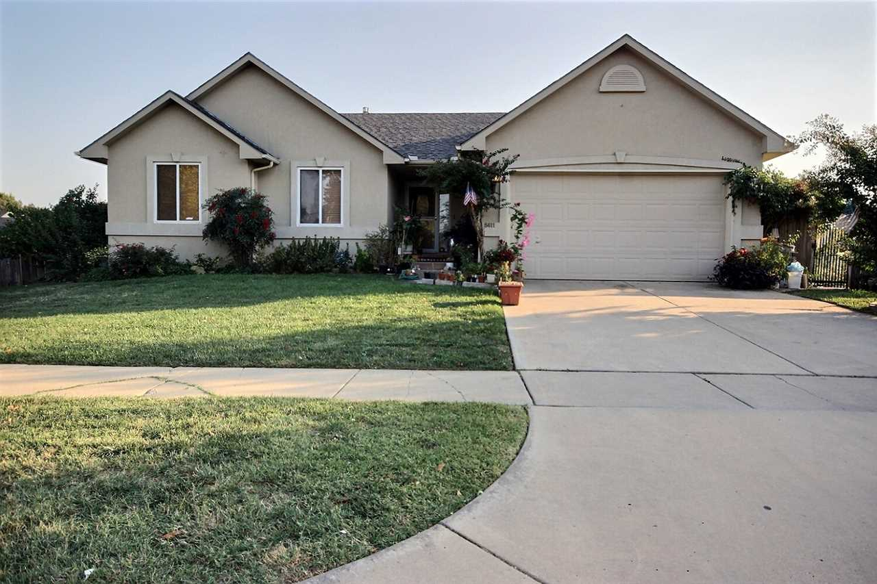 BACK ON THE MARKET! Welcome home! This well maintained beauty in SE Wichita has a beautifully landsc