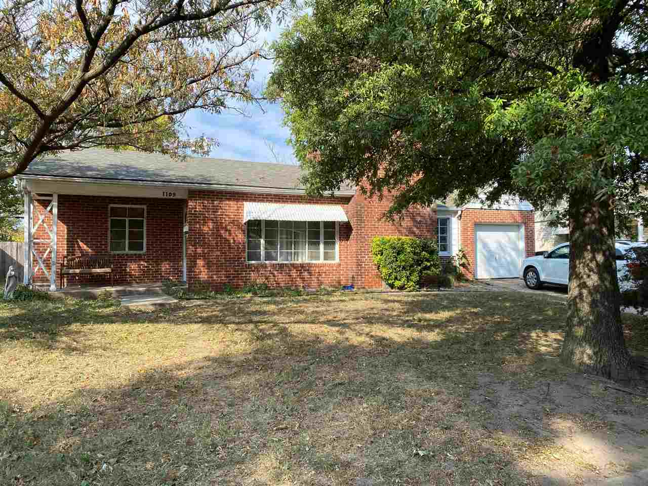 Must See! Brick Ranch with Large bedrooms, attached garage, Big Fenced Yard, Nice Sized Kitchen, Fir