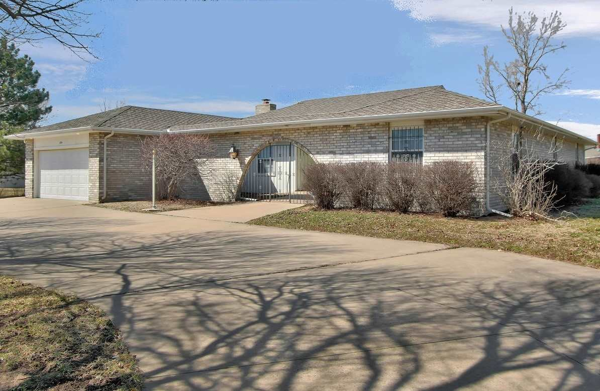 This house is BEAUTIFUL!!! Zero entry, one level home, perfect for EVERYONE! Over 2300 square feet of perfection all on one level. Small cellar under garage for storm safety. The main entry takes you to a large living room that could be used for both living and formal dining! Big bright windows for natural light. The kitchen is BRAND NEW! Island with contrasting wood, granite counter tops, new appliances, coffee bar area and more! Shares a breakfast nook and lovely hearth room with wood burning fireplace! Master bedroom is a DREAM. Take a look at this shower! Granite counters, double sinks and AWESOME walk in closet.  Split bedroom plan with two additional bedrooms, BOTH with walk in closets, and another full bath. Large laundry room with wash sink. This home sits on a large corner lot with circle drive and huge fenced back yard. 2 car garage with third car pad. Small shed in back yard with spacious covered patio. 50 year shingles allow for great insurance discounts! Located in Quail Creek Estates within walking distance to the YMCA and near hospital, shopping and quick access to highway.