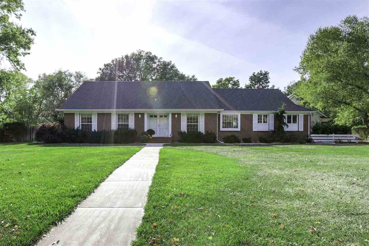 Looking for the perfect home in Newton to call your own? This gorgeous full brick mid-century Dutch