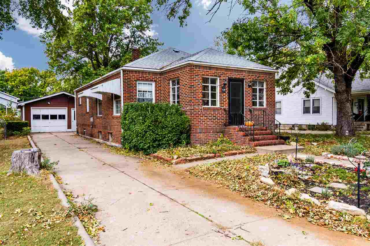 Don't miss your opportunity to own this beautiful brick home! The main floor features two bedrooms,