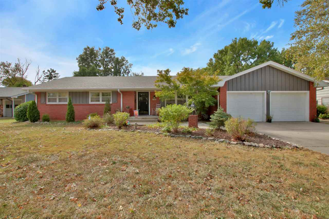 Looking for clean and move in ready?  This is it! Low maintenance brick ranch located in beautifully