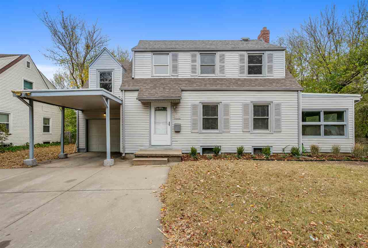 Phenomenal opportunity to own an immaculate home that is totally move in ready! Nothing is left for you to do but bring your furniture and start enjoying the amazing refinished hardwood floors, huge chefs kitchen, and generous backyard. Newer, energy efficient windows will help keep you warm in the winter, cool in the summer AND with lower utility bills. Low maintenance, vinyl siding will look terrific for years, so no more painting! Tired of working in a dark basement? The large and bright main floor bonus room provides ample space for that home office or craft room or play room or....Central location and only a minute to 135 means you are just minutes to anywhere in Wichita!