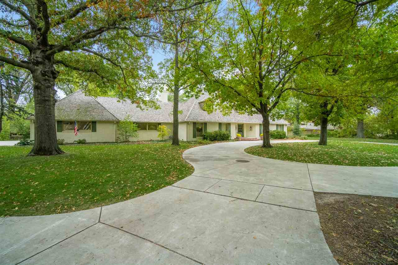 Luxurious living tucked back in the Vickridge neighborhood with circle drive and tons of mature tree
