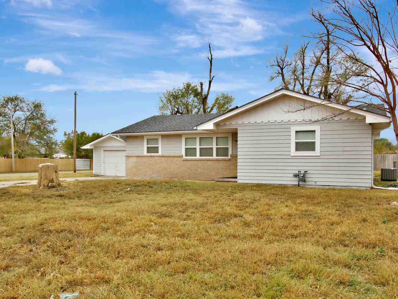Move in ready home on a 1/2 acre lot in west Wichita! Nicely updated 4 bedroom home with large rooms
