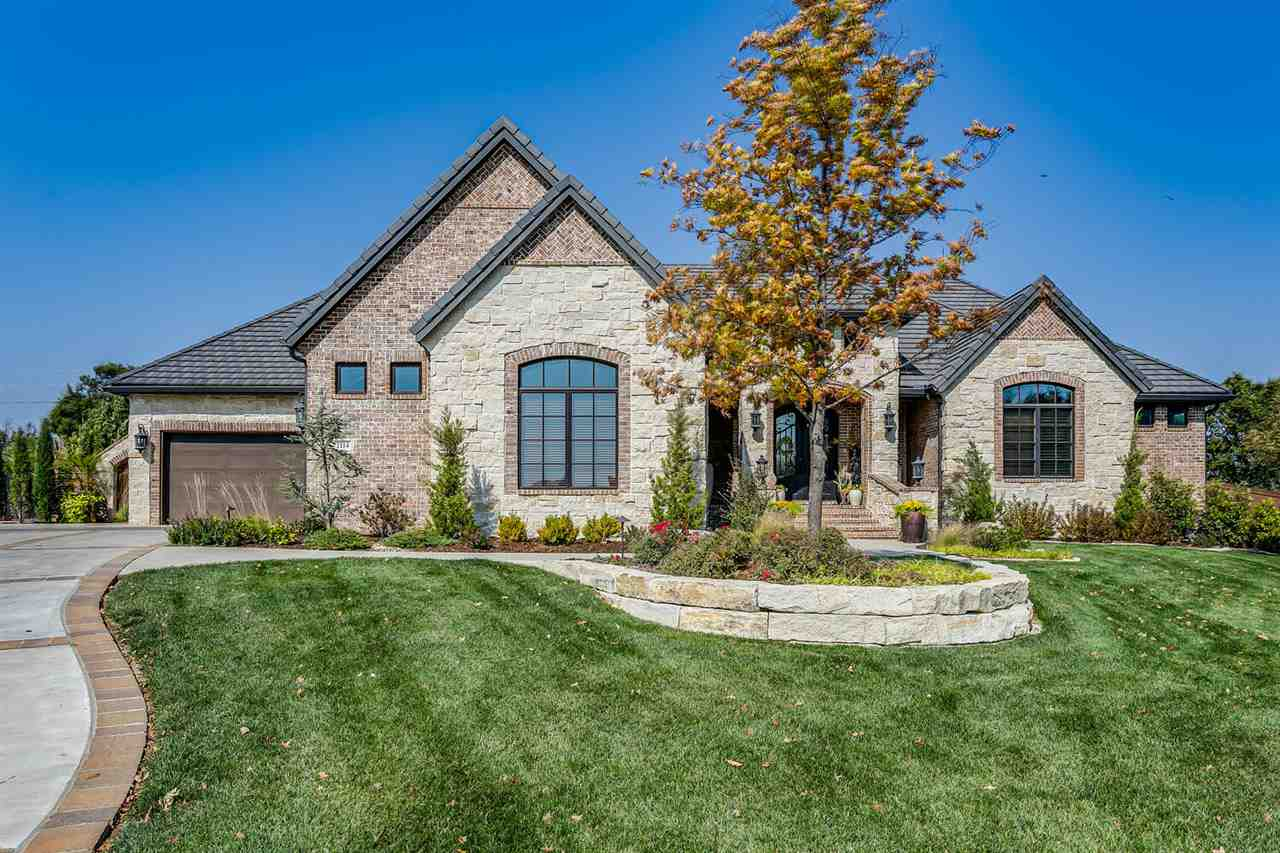 RESORT LIVING in this STUNNING 6,100 square foot custom estate by Craig Sharp Homes nestled on 2/3 a