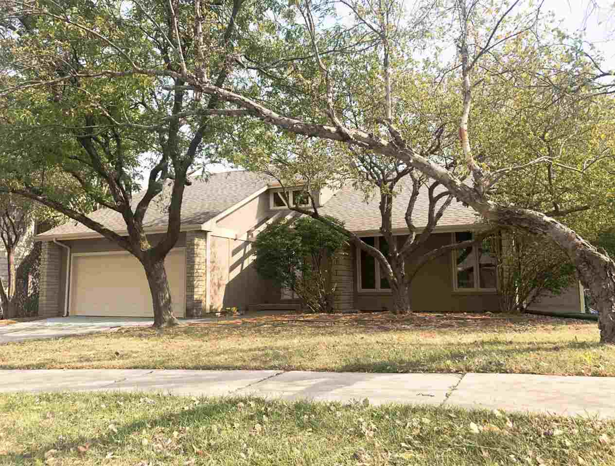 This spacious, single-family home on the East side of Wichita features both modern amenities and arc