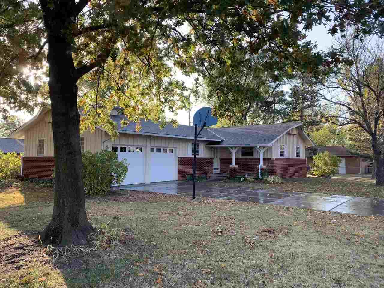 Situated on a corner lot, this 3 bedroom and 1 1/2  bathroom home offers classic hardwood floors thr