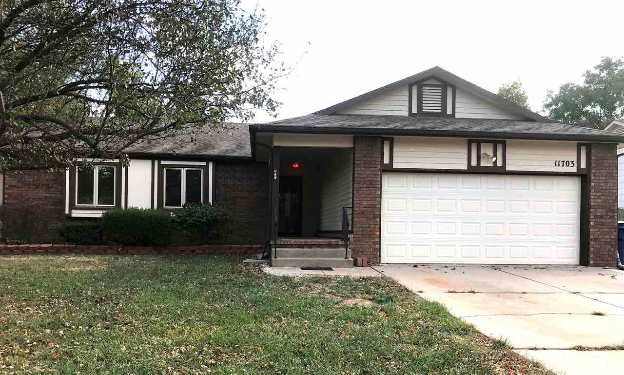 Spacious 4 bedroom, 3 bath home with 2 car garage, Open kitchen into the dining area, large master b