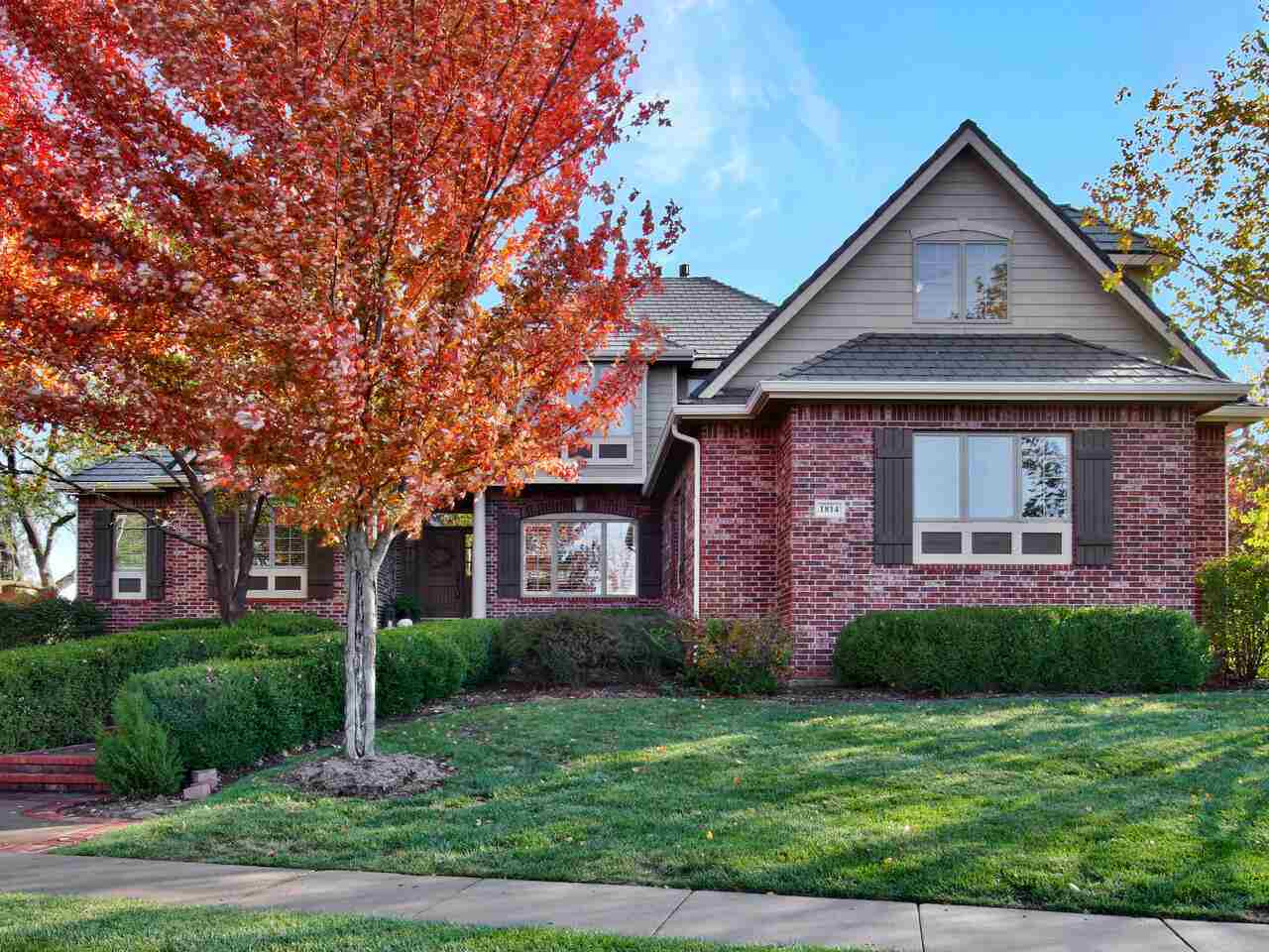 Welcome Home to this warm and inviting 1 1/2 story situated on a beautifully landscaped over half an